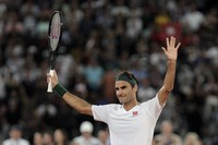 In this Feb. 7, 2020 file photo, Roger Federer thanks the crowd after winning 3 sets to 2 against Rafael Nadal in their exhibition tennis match held at the Cape Town Stadium in Cape Town, South Africa. (AP Photo/Halden Krog)