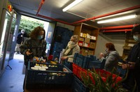 Students from the Free University of Brussels pick up products at the Frigo Partage food bank in Brussels on March 8, 2021. (AP Photo/Virginia Mayo)