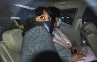 In this Feb. 22, 2021 file photo, climate activist Disha Ravi, 22, is seen in a car as she is taken to a court in New Delhi, India. (AP Photo/Dinesh Joshi)