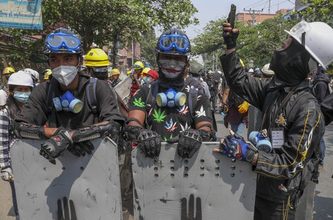 Anti-coup protesters with makeshift shields take positions in Mandalay, Myanmar, on March 9, 2021. (AP Photo)