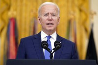 U.S. President Joe Biden speaks during an event to mark International Women's Day on March 8, 2021, in the East Room of the White House in Washington. (AP Photo/Patrick Semansky)