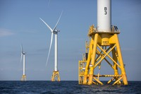 In this Aug. 15, 2016 file photo, three of Deepwater Wind's turbines stand in the water off Block Island, Rhode Island. (AP Photo/Michael Dwyer)