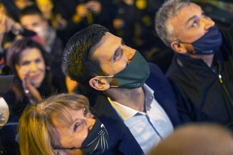 Novak Djokovic, center, Serbian tennis player, is surrounded by fans as he arrives at a restaurant in Belgrade, Serbia, on March 8, 2021. (AP Photo/Marko Drobnjakovic)