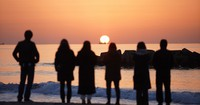 People are seen observing the rising sun from the Arahama district, in Sendai's Wakabayashi Ward, on the 10th anniversary of the March 2011 Great East Japan Earthquake and tsunami on March 11, 2021. (Mainichi/Tatsuro Tamaki)