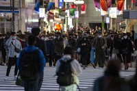People head toward the train station in Tokyo on March 14, 2021, as restaurants and bars close at 8 p.m. to comply with the rules of the state of emergency. (AP Photo/Kiichiro Sato)