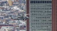 This still image taken from a video shows a U.S. Navy Seahawk helicopter flying by 124-meter-tall Carrot Tower in Tokyo's Setagaya Ward, on Dec. 14, 2020. (Mainichi/Hiroyuki Oba)