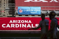 """In this Dec. 26, 2020, file photo, An """"NFL on prime video"""" banner hangs on the field prior to an NFL football game between the San Francisco 49ers and Arizona Cardinals in Glendale, Ariz. (AP Photo/Jennifer Stewart)"""