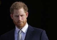 In this Thursday, Jan. 16, 2020,file photo, Britain's Prince Harry arrives in the gardens of Buckingham Palace in London. (AP Photo/Kirsty Wigglesworth, File)