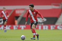Southampton's Takumi Minamino controls the ball during an English Premier League soccer match between Southampton and Brighton at the St Mary's Stadium in Southampton, U.K., on March 14, 2021. (Mike Hewitt/Pool via AP)