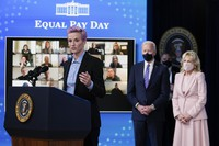 United States Soccer Women's National Team member Megan Rapinoe speaks as President Joe Biden and first lady Jill Biden look on during an event to mark Equal Pay Day in the South Court Auditorium in the Eisenhower Executive Office Building on the White House Campus on March 24, 2021, in Washington. (AP Photo/Evan Vucci)