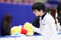 """Yuzuru Hanyu touches a """"Winnie the Pooh"""" tissue cover at the Japan Figure Skating Championships in Nagano, on Dec. 25, 2020. (Pool photo)"""