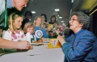 In this April 19, 1998 file photo, Beverly Cleary signs books at the Monterey Bay Book Festival in Monterey, California. (Vern Fisher/The Monterey County Herald via AP)