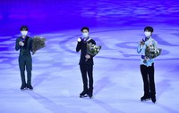 First placed Nathan Chen of the U.S.A., center, holds his gold medal with second placed Yuma Kagiyama of Japan, left, and third placed Yuzuru Hanyu of Japan, right, during the Men Free Skating Program at the Figure Skating World Championships in Stockholm, Sweden, on March 27, 2021. (AP Photo/Martin Meissner)