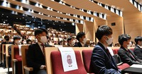 An entrance ceremony for first-year students at Sophia University, in which participants were in spaced seating, is seen being held a year late in Tokyo's Chiyoda Ward on March 29, 2021. (Mainichi/Takehiko Onishi)