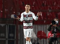 Portugal's Cristiano Ronaldo holding captain's armband, left, reacts during the World Cup 2022 group A qualifying soccer match against Serbia at the Rajko Mitic stadium in Belgrade, Serbia, on March 27, 2021. (AP Photo/Darko Vojinovic)