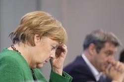 ロックダウン(都市封鎖)の強化策を発表し、記者会見に臨むメルケル独首相=ベルリンで2021年3月23日、AP