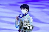 Yuzuru Hanyu of Japan holds his bronze medal after the men's free skate program at the World Figure Skating Championships in Stockholm, Sweden, on March 27, 2021. (AP Photo/Martin Meissner)