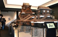 A model of Kumamoto Castle's two keeps is seen in the main keep, in Kumamoto's Chuo Ward on April 6, 2021. Some walls and roof sections have been left off so that visitors can see the structure inside. (Mainichi/Yuki Kurisu)