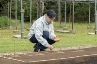 Emperor Naruhito sprinkles rice seeds on a seedling bed at the Imperial Palace on April 6, 2021. (Photo courtesy of the Imperial Household Agency)