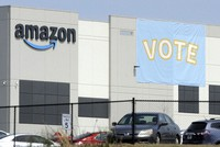In this March 30, 2021 file photo, a banner encouraging workers to vote in labor balloting is seen at an Amazon warehouse in Bessemer, Alabama. (AP Photo/Jay Reeves)