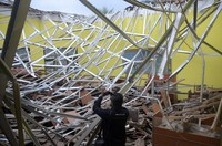 A local journalist films the damage to a class room at a school following an earthquake in Malang, East Java, Indonesia, on April 10, 2021. (AP Photo/Hendra Permana)