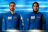 In this undated handout photo from the United Arab Emirates' state-run WAM news agency, newly named Emirati astronauts Mohammed al-Mulla, left, and Noura al-Matroushi, right, pose for a photo. (WAM via AP)
