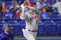 Los Angeles Angels' Shohei Ohtani watches his solo home run in front of Toronto Blue Jays catcher Alejandro Kirk during the fifth inning of a baseball game on April 9, 2021, in Dunedin, Florida. (AP Photo/Mike Carlson)