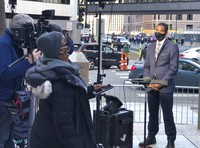 This image released by MSNBC shows Correspondent Shaquille Brewster, right, on location covering the the trial of former Minneapolis police officer Derek Chauvin in Minneapolis, Minn., on Wednesday April 7, 2021. (MSNBC via AP)