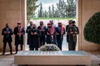 This photo from the Royal Court twitter account, shows Jordan's King Abdullah II, center, Prince Hamzah bin Al Hussein, second left, and others during a visit to the tomb of the late King Hussein, in Amman Jordan, Sunday, April 11, 2021. (Royal Court Twitter Account via AP)