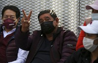 Felix Salgado flashes a V hand sign during a protest outside the Electoral Tribunal to demand a reversal of the decision to remove him as a gubernatorial candidate, in Mexico City, on April 7, 2021.  (AP Photo/Fernando Llano)