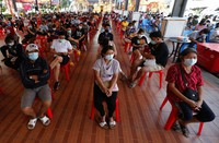 People wait to receive the Sinovac COVID-19 vaccine in Bangkok, Thailand, on April 12, 2021. (AP Photo/Sakchai Lalit)