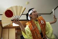 Olympic fan Kyoko Ishikawa shows her cheering at her home on April 10, 2021, in Tokyo. (AP Photo/Eugene Hoshiko)