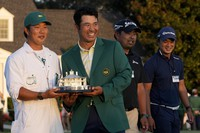 Hideki Matsuyama, of Japan, holds his trophy with his caddie Shota Hayafuji after winning the Masters golf tournament on April 11, 2021, in Augusta, Ga. (AP Photo/David J. Phillip)