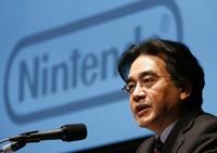 In this Jan. 31, 2013, file photo, then Nintendo Co. President Satoru Iwata speaks during a news conference in Tokyo. (AP Photo/Koji Sasahara, File)