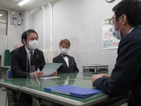 Toda municipal assemblyman Super Crazy-kun, center, is seen with his lawyer, left, as they file a petition to review the Toda election commission's decision to nullify his election victory with the Saitama prefectural election commission at the Saitama Prefectural Government building, on April 13, 2021. (Mainichi/Shoko Washizu)