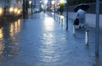 This photo shows a street flooded by heavy rains in Ichikawa, Chiba Prefecture, on March 13, 2021. (Mainichi/Masahiro Ogawa)