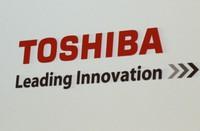 In this June 15, 2017 file photo, the logo of Toshiba Corp., Japan's electronics and energy company, is seen on a screen during a press conference in Yokosuka, near Tokyo. (AP Photo/Shuji Kajiyama)