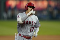 Los Angeles Angels designated hitter Shohei Ohtani gestures while rounding the bases during the fifth inning of a baseball game against the Kansas City Royals at Kauffman Stadium in Kansas City, Missouri, on April 13, 2021. Ohtani hit a solo home run on the play. (AP Photo/Orlin Wagner)