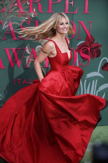 Michelle Hunziker is seen upon her arrival at the Green Carpet Fashion Awards in Milan, Italy, on Sept. 22, 2019. (AP Photo/Luca Bruno)