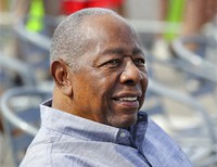Baseball Hall of Famer Hank Aaron smiles as he is honored with a street named after him outside CoolToday Park, the spring training baseball facility of the Atlanta Braves, in North Port, Fla., in this Feb. 18, 2020, file photo. (Curtis Compton/Atlanta Journal-Constitution via AP)