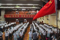 Students attend a flag raising ceremony during the National Security Education Day at a secondary school, in Hong Kong, on April 15, 2021. (AP Photo/Kin Cheung)