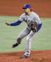 Texas Rangers starter Kohei Arihara watches a throw to a Tampa Bay Rays batter during the fourth inning of a baseball game on April 14, 2021, in St. Petersburg, Fla. (AP Photo/Steve Nesius)