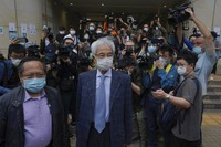 Pro-democracy activists Martin Lee, center, and Albert Ho, left, arrive at a court in Hong Kong on April 16, 2021. (AP Photo/Kin Cheung)