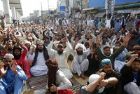 Supporters of Tehreek-e-Labiak Pakistan, a radical Islamist political party, chant slogans during a protest against the arrest of their party leader, Saad Rizvi, in Lahore, Pakistan, on April 15, 2021. (AP Photo/K.M. Chaudary)