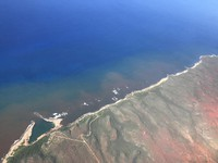 In this 2020 aerial photo provided by the Arizona State University's Global Airborne Observatory, runoff from the island of Molokai in Hawaii flows into the ocean. (Global Airborne Observatory, Arizona State University via AP)