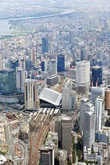 Tall buildings in the Umeda neighborhood of Kita Ward, Osaka, are seen in this file photo taken from a Mainichi Shimbun helicopter on Aug. 1, 2020. (Mainichi/Takao Kitamura)