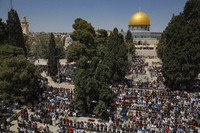 Palestinian worshipers pray during the first Friday of the holy month of Ramadan at the Al Aqsa Mosque compound in Jerusalem's old city, on April. 16, 2021. (AP Photo/Mahmoud Illean)