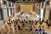 People wait at a vaccination center in Milan, Italy, on April 16, 2021.  (Claudio Furlan/LaPresse via AP)