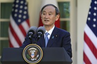 Japanese Prime Minister Yoshihide Suga, speaks at a news conference with President Joe Biden in the Rose Garden of the White House, on April 16, 2021, in Washington. (AP Photo/Andrew Harnik)