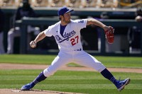 In this March 1, 2021, file photo, Los Angeles Dodgers starting pitcher Trevor Bauer throws against the Colorado Rockies during the first inning of a spring training baseball game in Phoenix. (AP Photo/Ross D. Franklin)